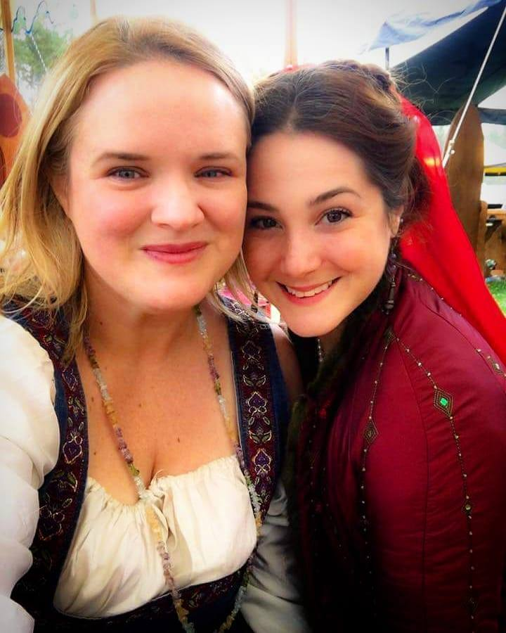 Two women wearing medieval and Renaissance clothing posing together